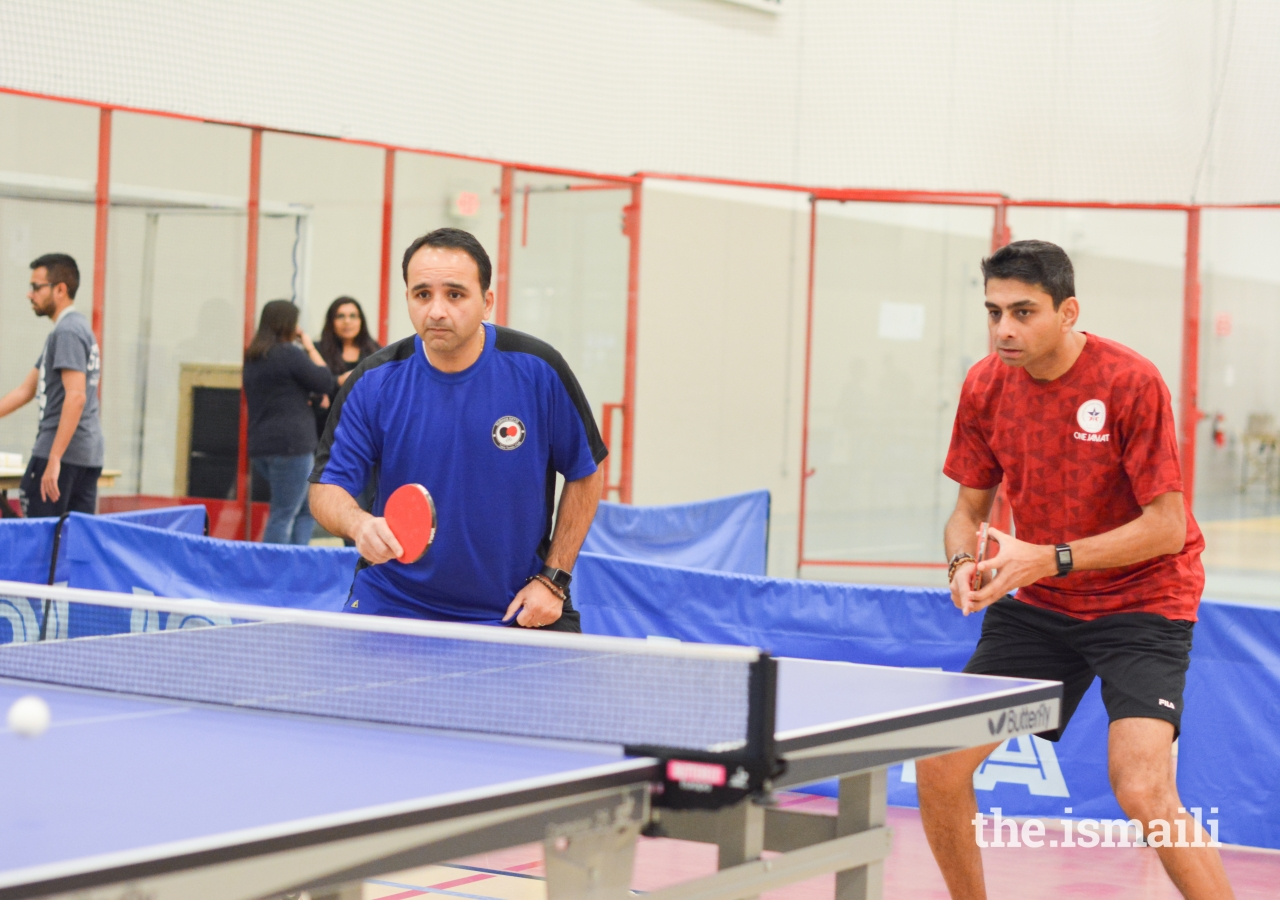 Nazim Nizar and Malik Hashwani concentrate on the fast serve from their opponents.