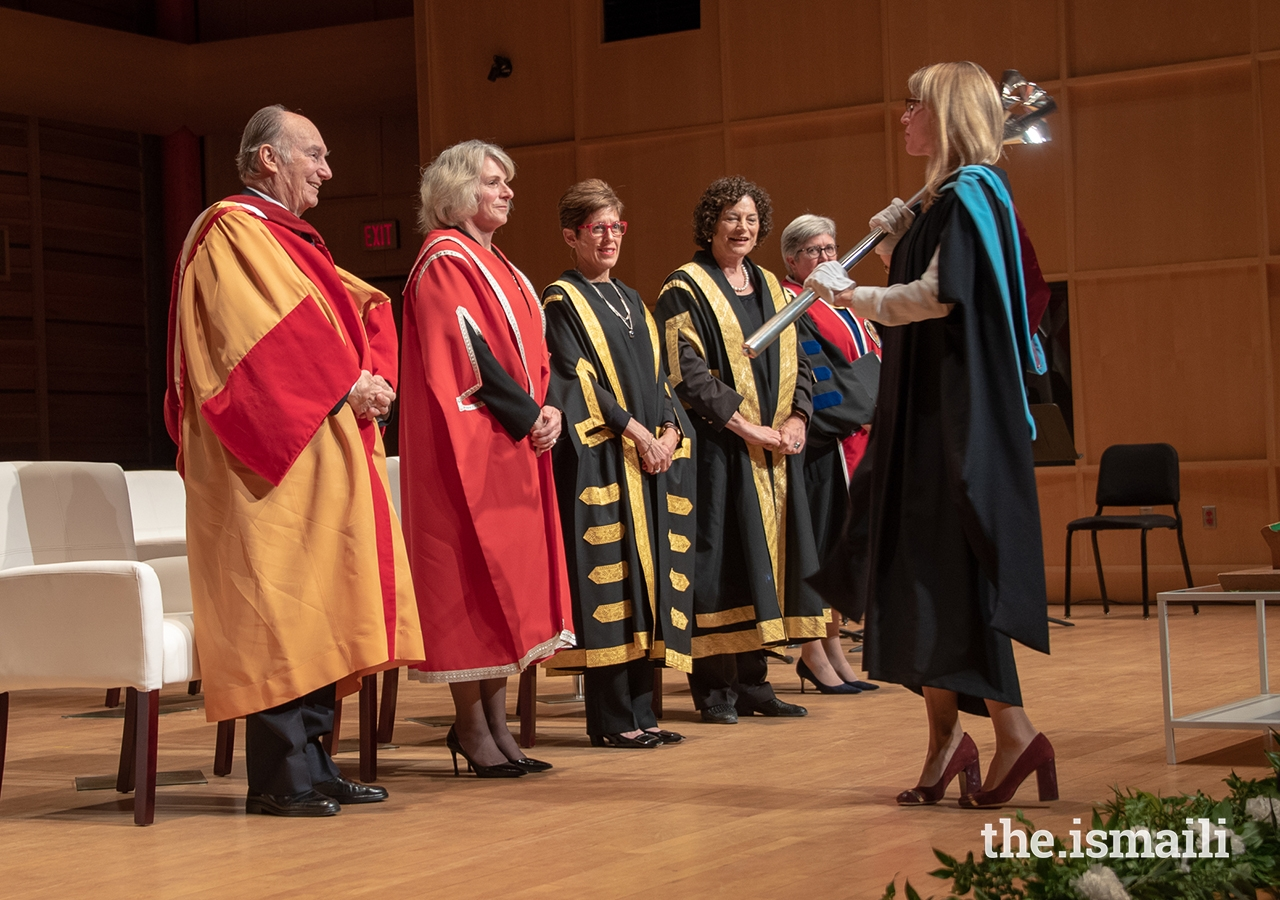 University of Calgary Registrar Angelique Saweczko yields the ceremonial mace at the honorary degree conferral ceremony at the University of Calgary.
