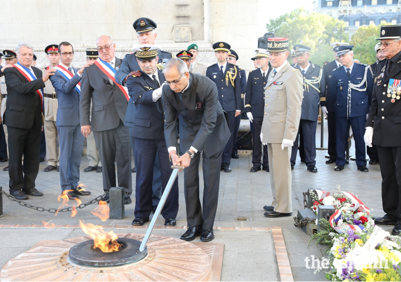 The Indian Ambassador in France reignites the flame at the Tomb of the Unknown Solder at the Arc de Triomphe in Paris.