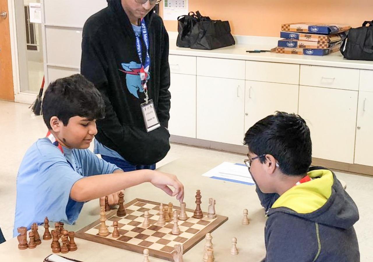 Aydin Merchant strategizing as Sinan Huda makes his next move.