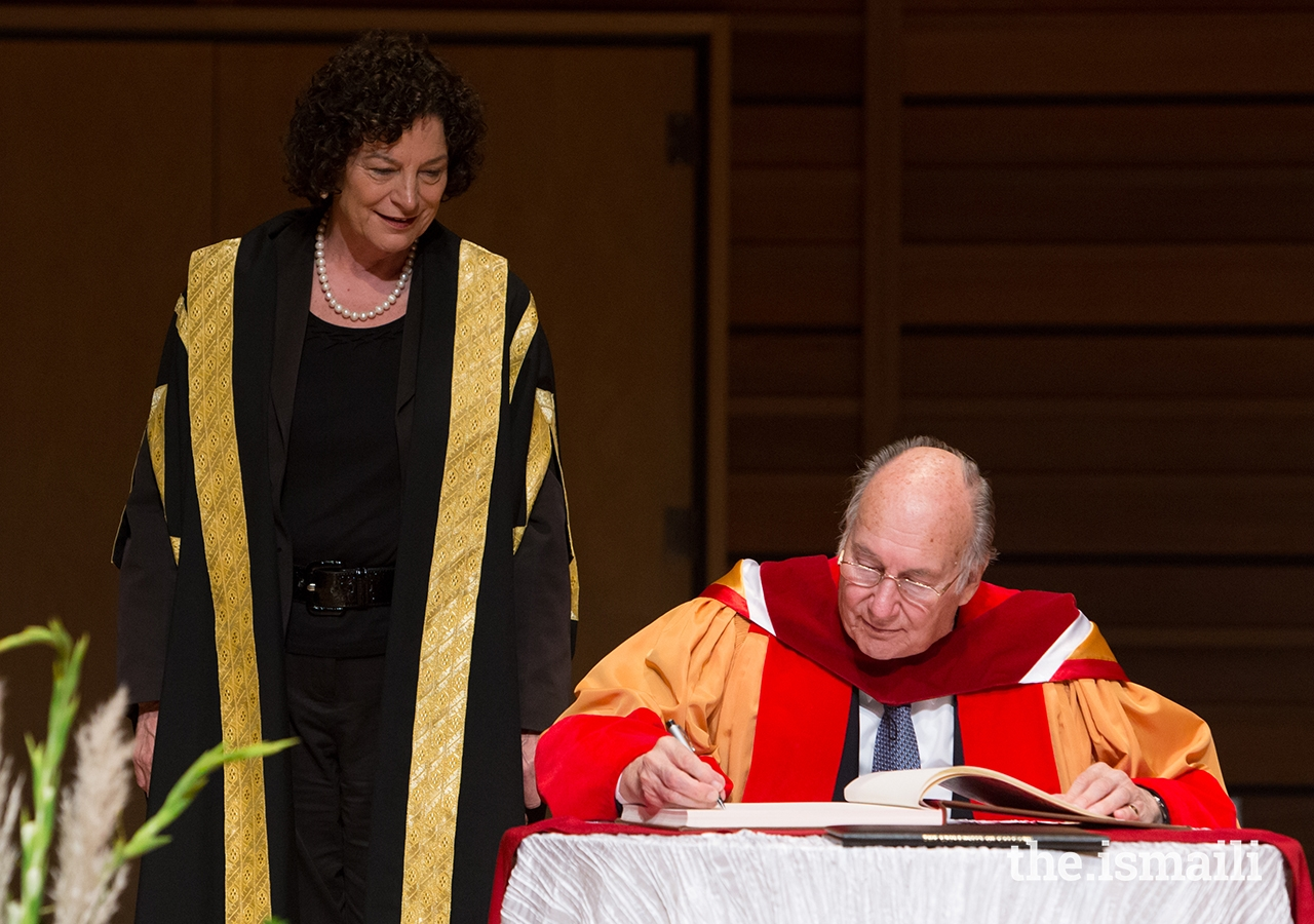 Mawlana Hazar Imam completes the honorary degree conferral ceremony with the signing of the register.
