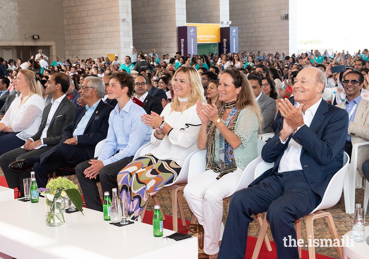 Prince Amyn, Princess Zahra, Miss Sara Boyden, and Master Iliyan Boyden enjoy a performance at the International Talent Showcase.
