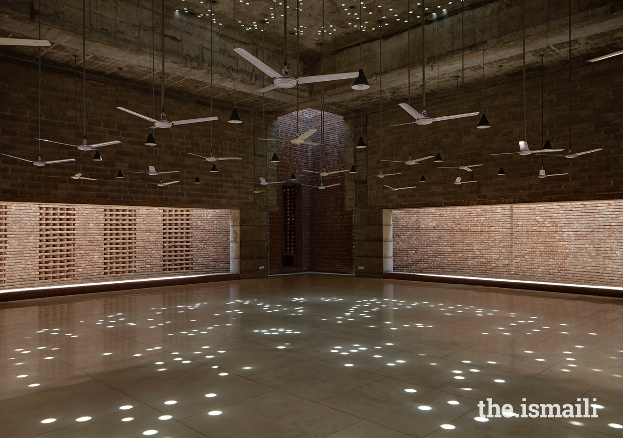 The Bait Ur Rouf Mosque in Dhaka, Bangladesh. Random circular roof openings allow daylight into the prayer hall creating an ornate pattern on the floor, enhancing spirituality through light.