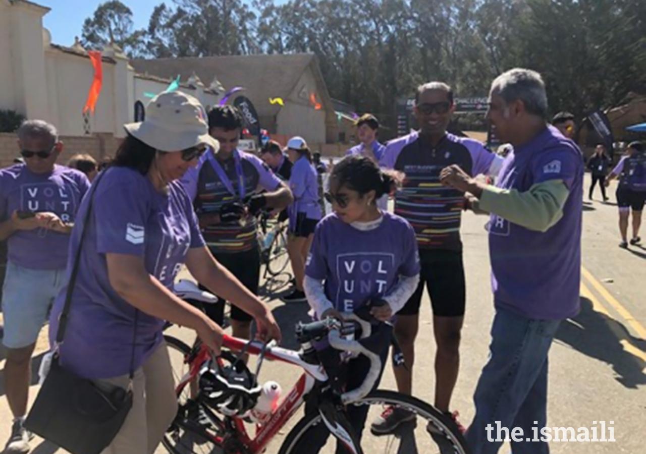 Volunteers in action, helping riders put away their bikes.