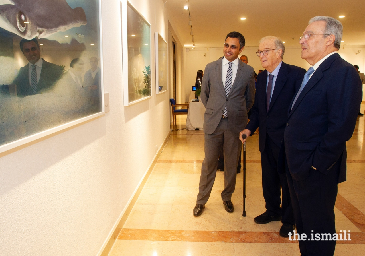 "Jorge Sampaio, former President of Portugal (centre) and Ambassador Vasco Valente (right) are guided around Prince Hussain's photographic exhibition ""The Living Sea"" by Rahim Firozali, President of the Ismaili Council for Portugal (left)."