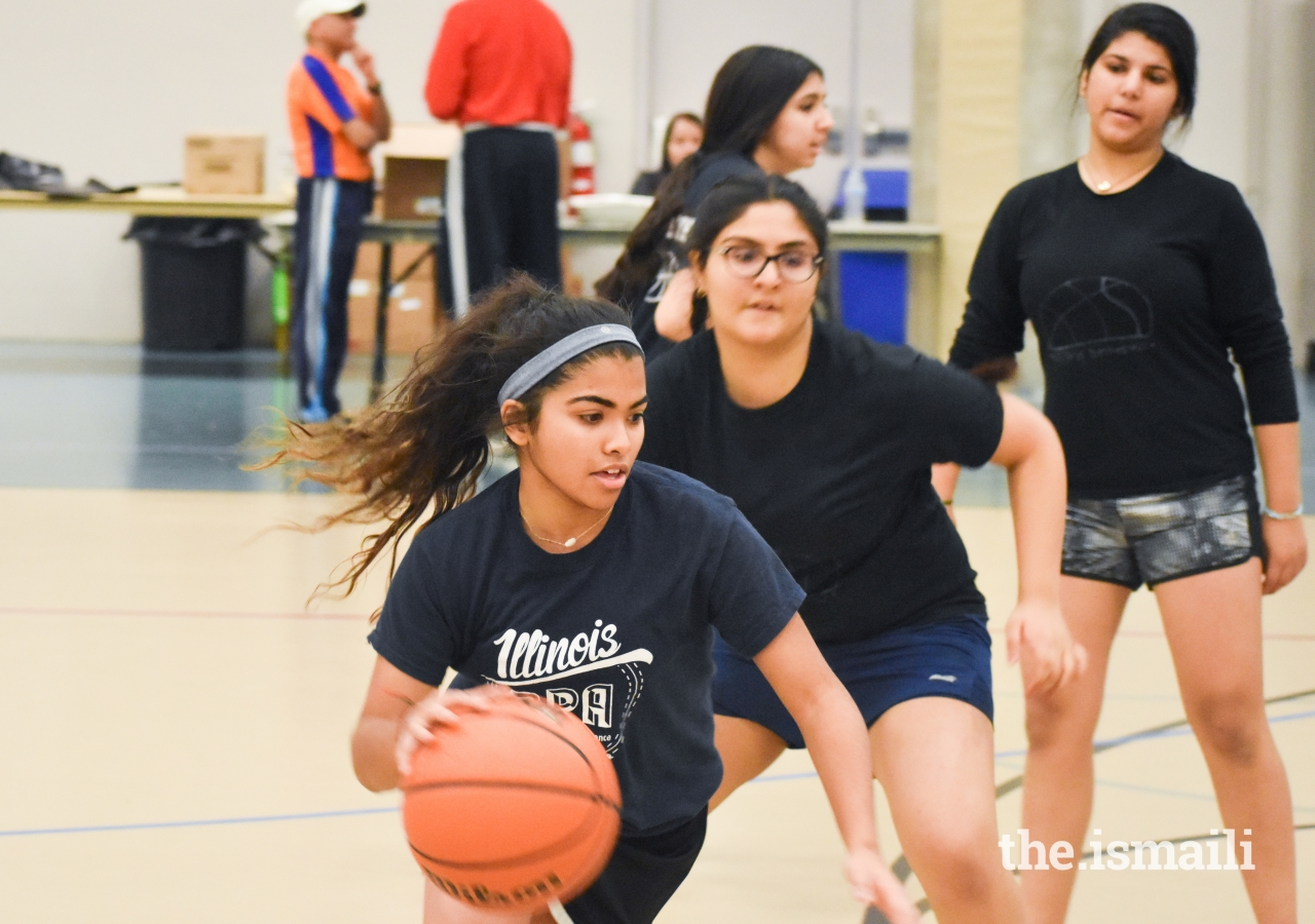 Saaniya Rupani tries to find an open shot, while battling a tough defense at the 2018 Midwest Regional Sports Tournament.