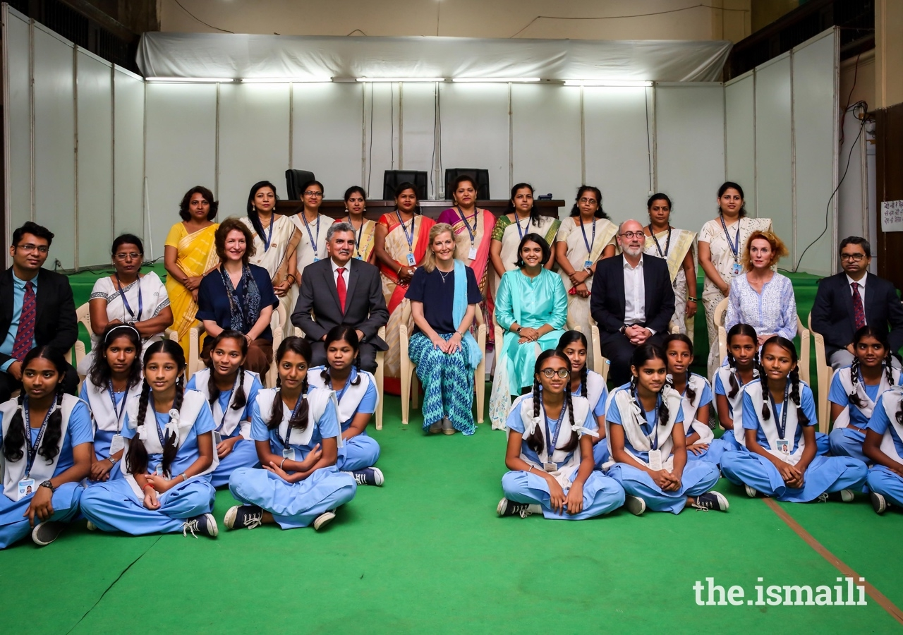 Her Royal Highness The Countess of Wessex (centre) poses for a group photograph with Crispin Simon, British Deputy High Commissioner for Western India, School children, teachers, and AKHS staff.