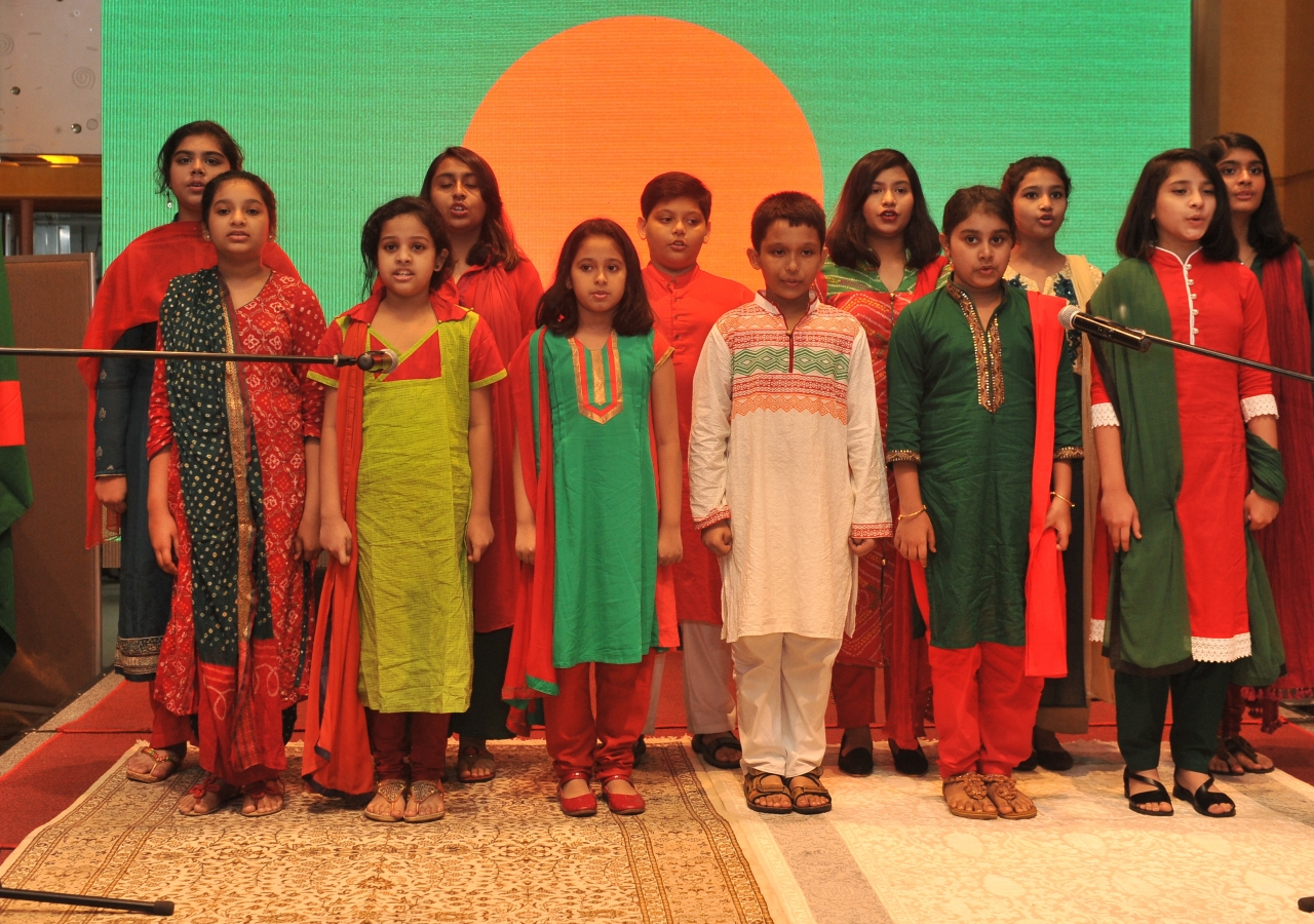 Students from the Aga Khan School, Dhaka, recite the National Anthem