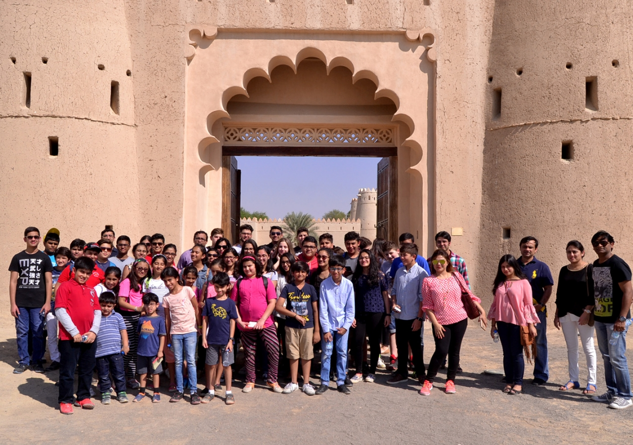 Students pose for a group photo in front of Al Jahili Fort, the venue of the 2016 Aga Khan Award for Architecture ceremony. Shuneal Shoukat Ali