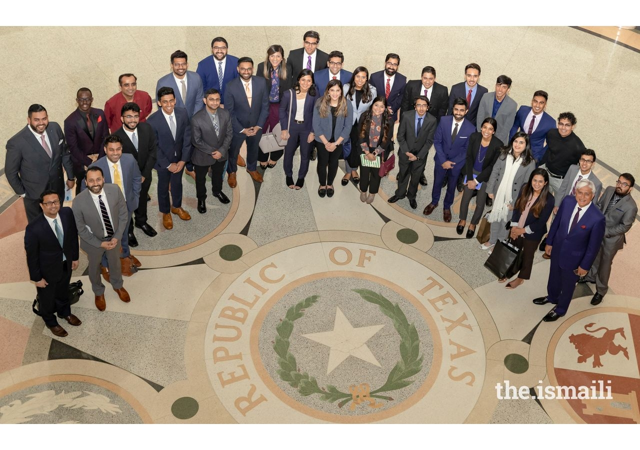 Participants looking up at the Rotunda during their tour of the Texas State Capitol Building.