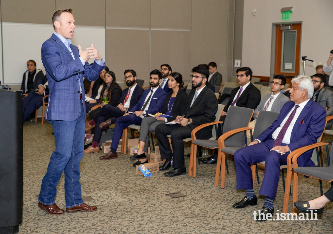 Texas Railroad Commissioner, Ryan Sitton, applauding the Ismaili community during his presentation, and also explaining his role and responsibilities as the Commissioner.