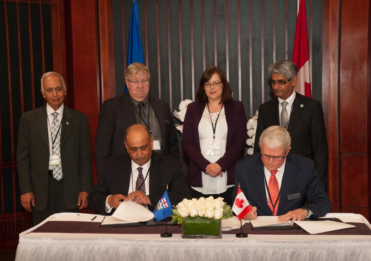CAB Chairman Karim Sunderji signs the Memorandum of Co-operation with Barry Marshall, President of ADRIA.