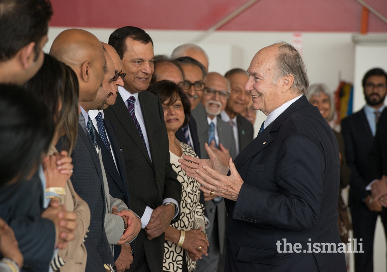 Mawlana Hazar Imam shares a light moment with Jamati leaders upon arrival in Vancouver.