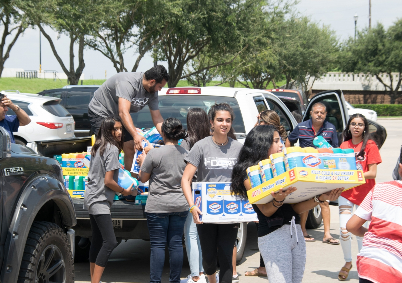I-CERV volunteers unloading supplies at Catholic Charities of the Archdiocese of Galveston-Houston's offices, as part of the Share Your Blessings drive.