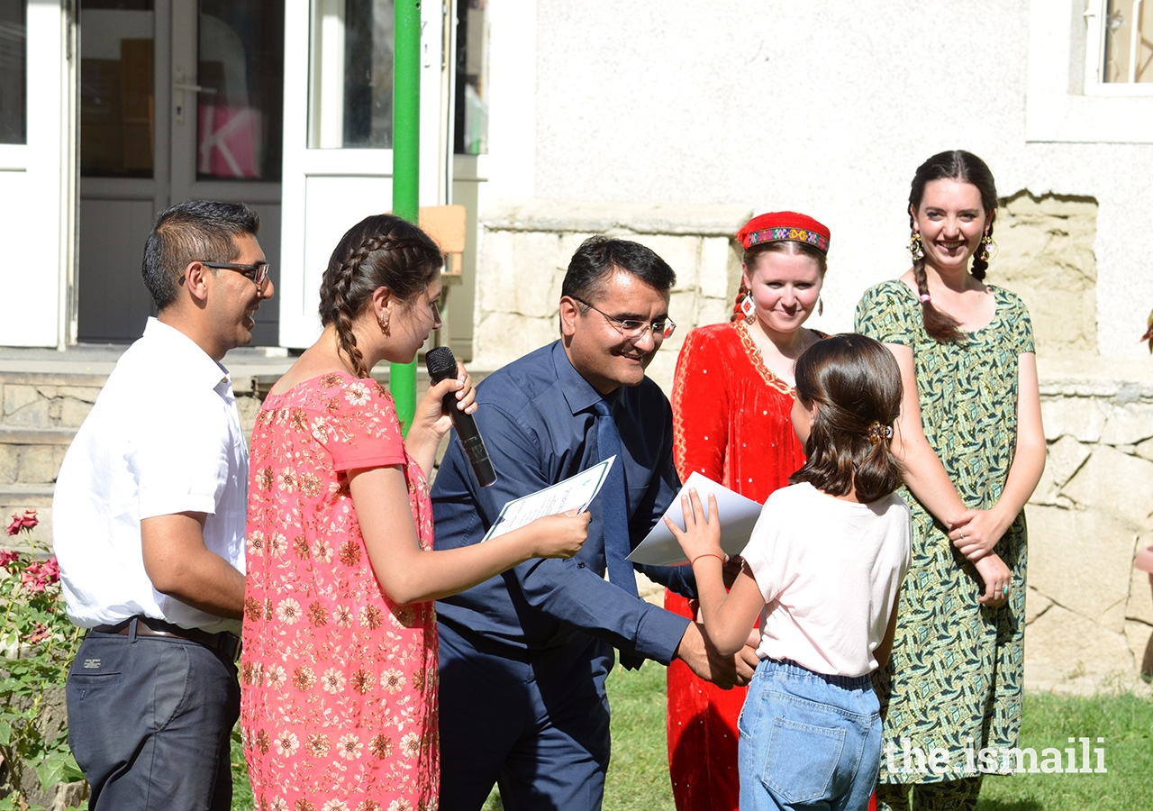 Participants receive certificates upon completion of the summer Makerspace Lab programme from Zuloby Mamadfozilov, AKES Tajikistan's CEO, and the programme facilitators, Faith Harron and Allison Armstrong.