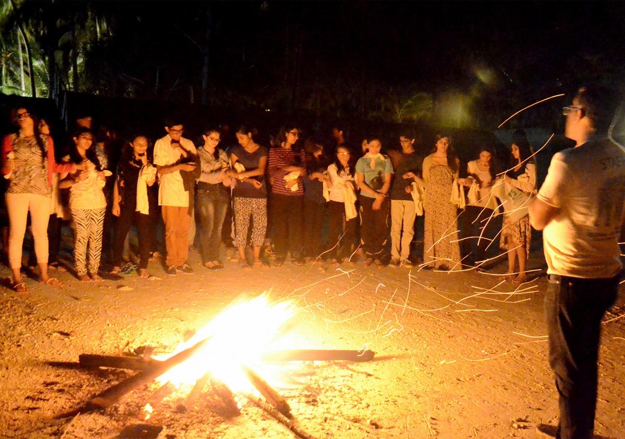 Global Encounters campers gather around a bonfire in Zanzibar. Saraan Jiwani