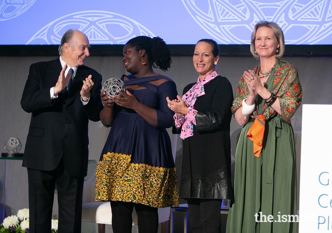 Deborah Ahenkorah, co-founder of Golden Baobab, poses for a photo with Mawlana Hazar Imam, Princess Zahra, and Global Centre for Pluralism Secretary General Meredith Preston McGhie.