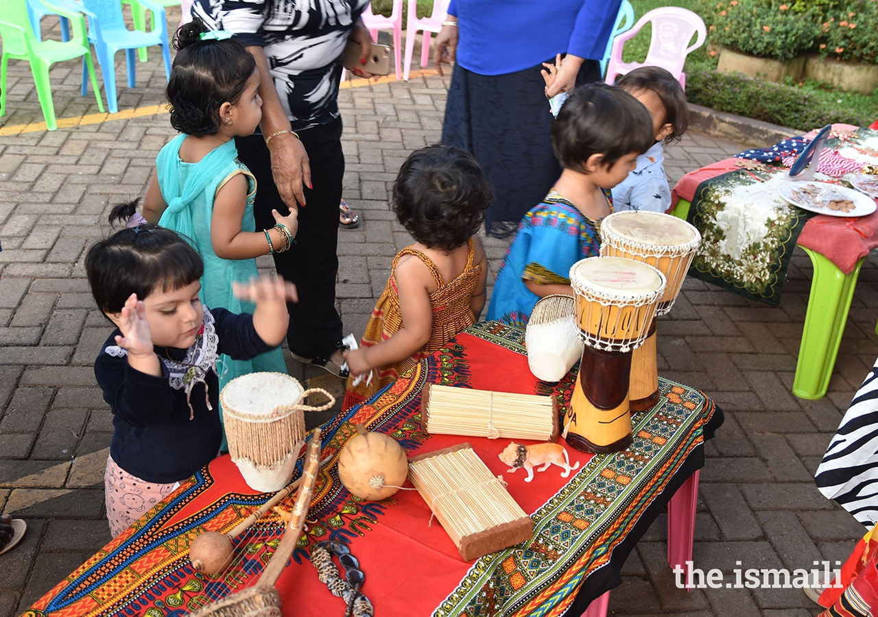 Children participate in Cultural Day, where students and teachers displayed flags, artifacts, currencies, and attire from different countries and dressed in traditional clothing representing the different cultures and traditions.