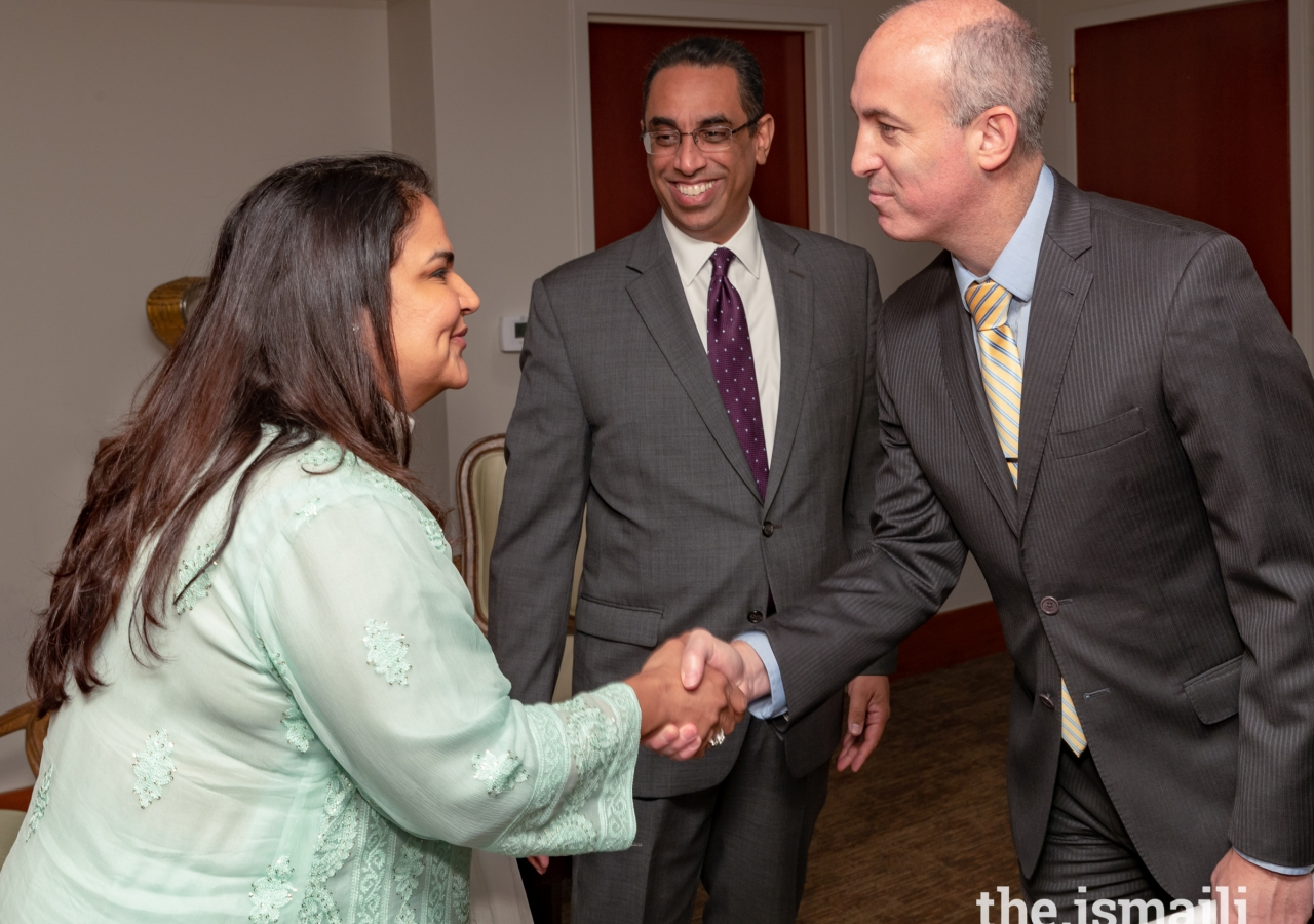 Ismaili Council leadership greeting guest at the Eid Luncheon. From left to right: Celina Shariff, Vice President, Aga Khan Council for USA; Al-Karim Alidina, President, Aga Khan Council for USA; Chris Olson, Director, Office of Trade and International Affairs, City of Houston.