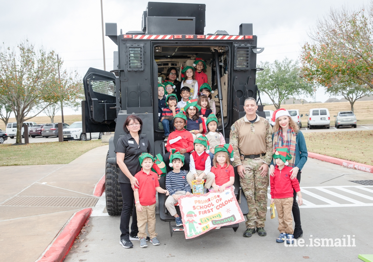 The Primrose School of First Colony posing with a SWAT officer of the Sugar Land Police Department