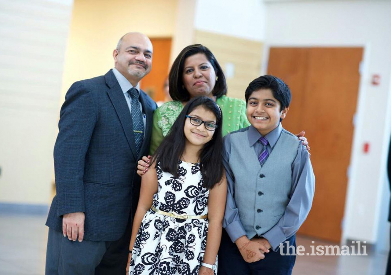 Farzana Gajani, who became a cosmetologist with the help of the Quality of Life Skills Development Initiative, pictured here with her family.
