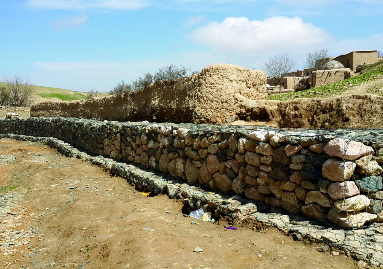 A gabion retaining wall protects Shah Hum village in Baghlan, Afghanistan from debris flow. FOCUS