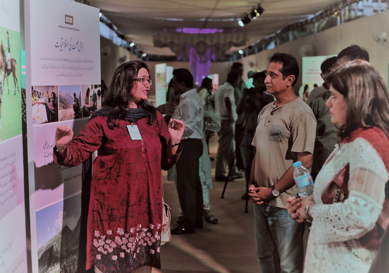 A tour guide explains the Ethic of Sound Mind to exhibition visitors