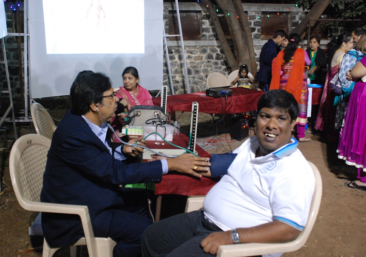 A man has his blood pressure checked at a Health Mantra event.