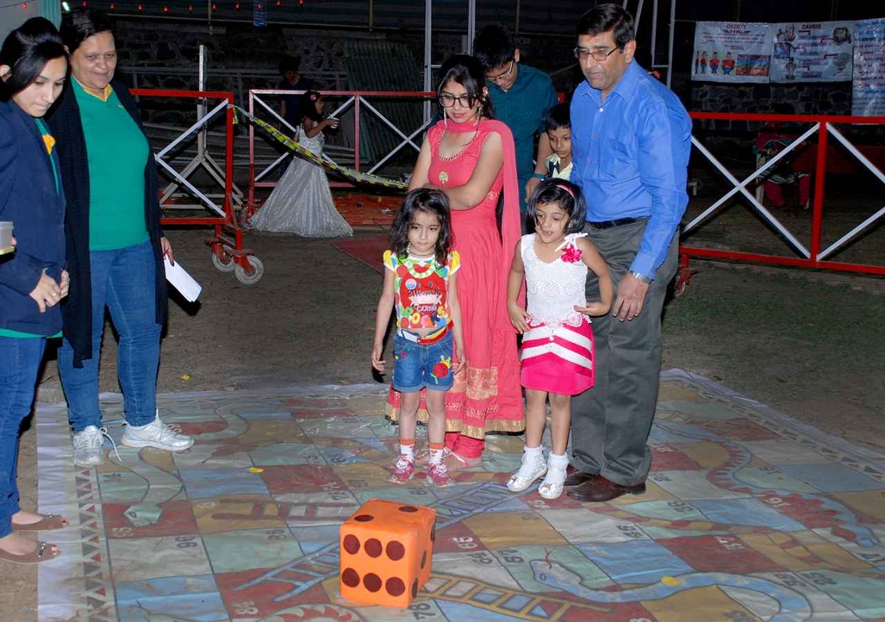 Games like Snakes and Ladders are being used to educate the Jamat about making healthier choices. AKHB India