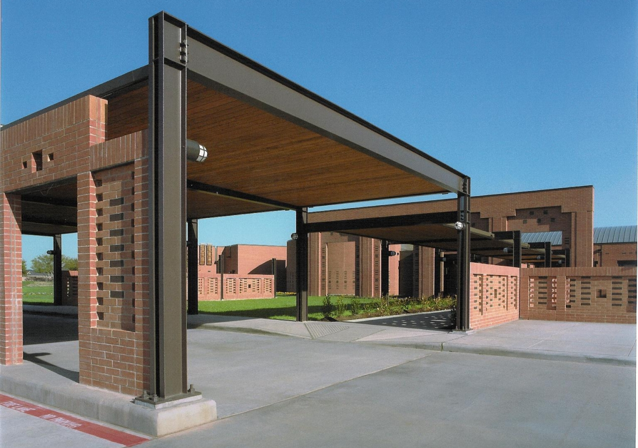 The porte-cochere and the entrance to the Center.
