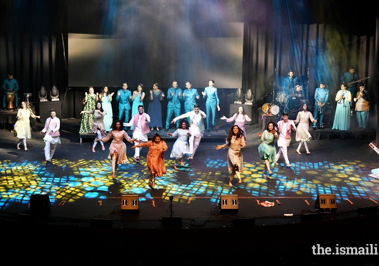 The entire troupe of dancers from Stories perform a swing routine to the sounds of live vocalists and instrumentalists as part of the show finale.
