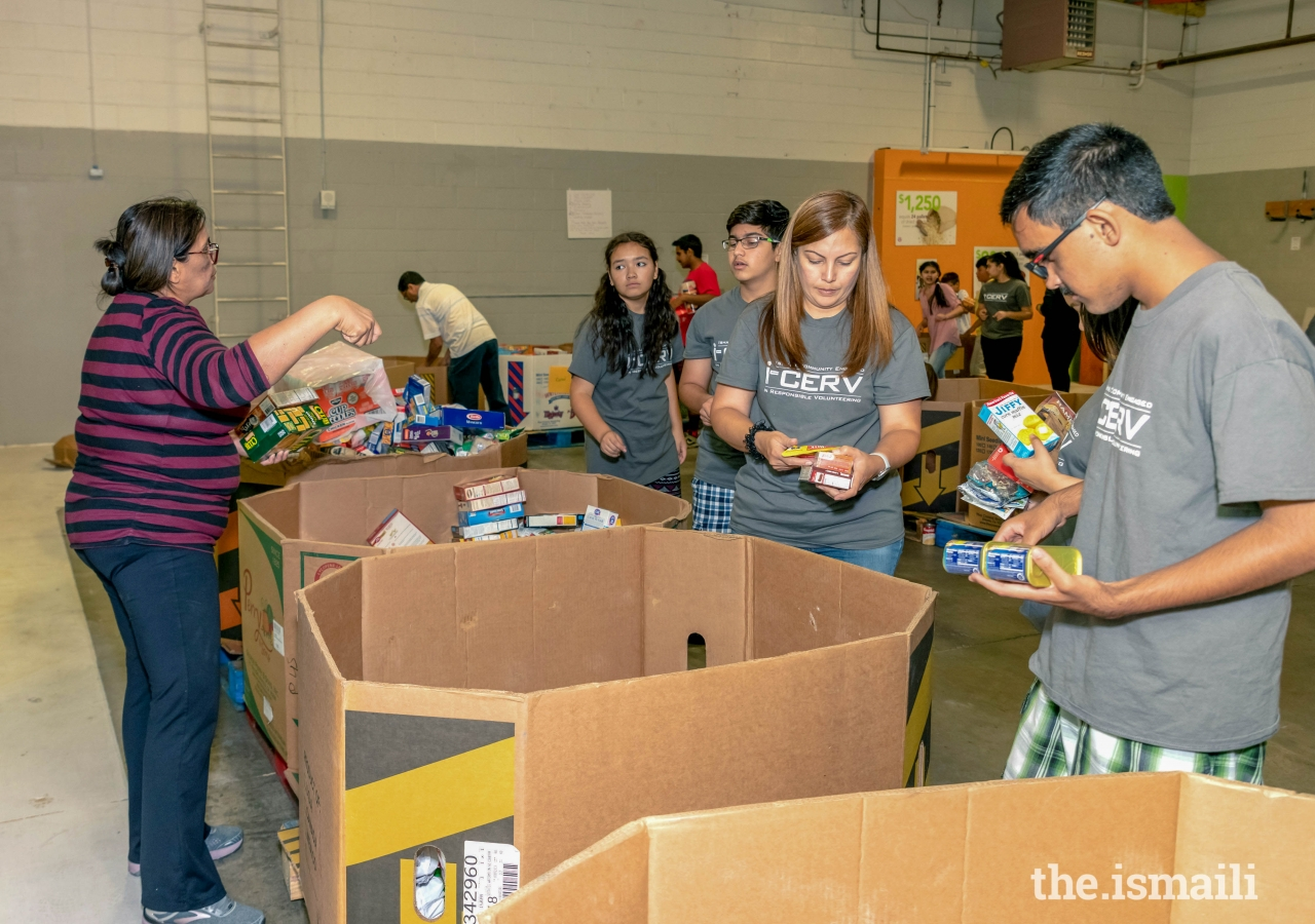 I-CERV volunteers organize donated items at the Milpitas Food Pantry.