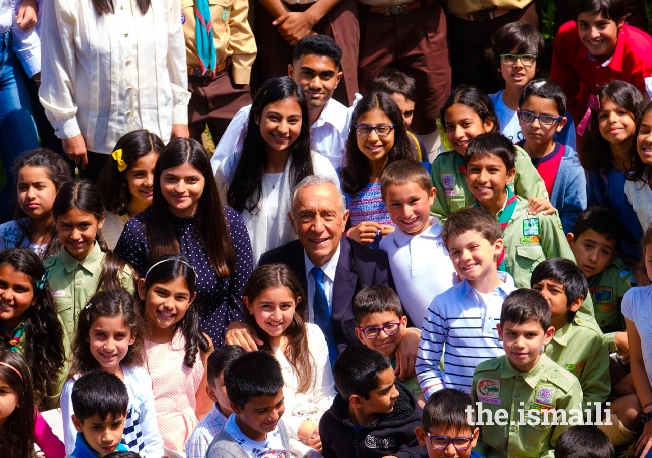 His Excellency Marcelo Rebelo de Sousa, President of the Portuguese Republic, surrounded by young Ismailis in the Garden of Fruits at the Ismaili Centre Lisbon.