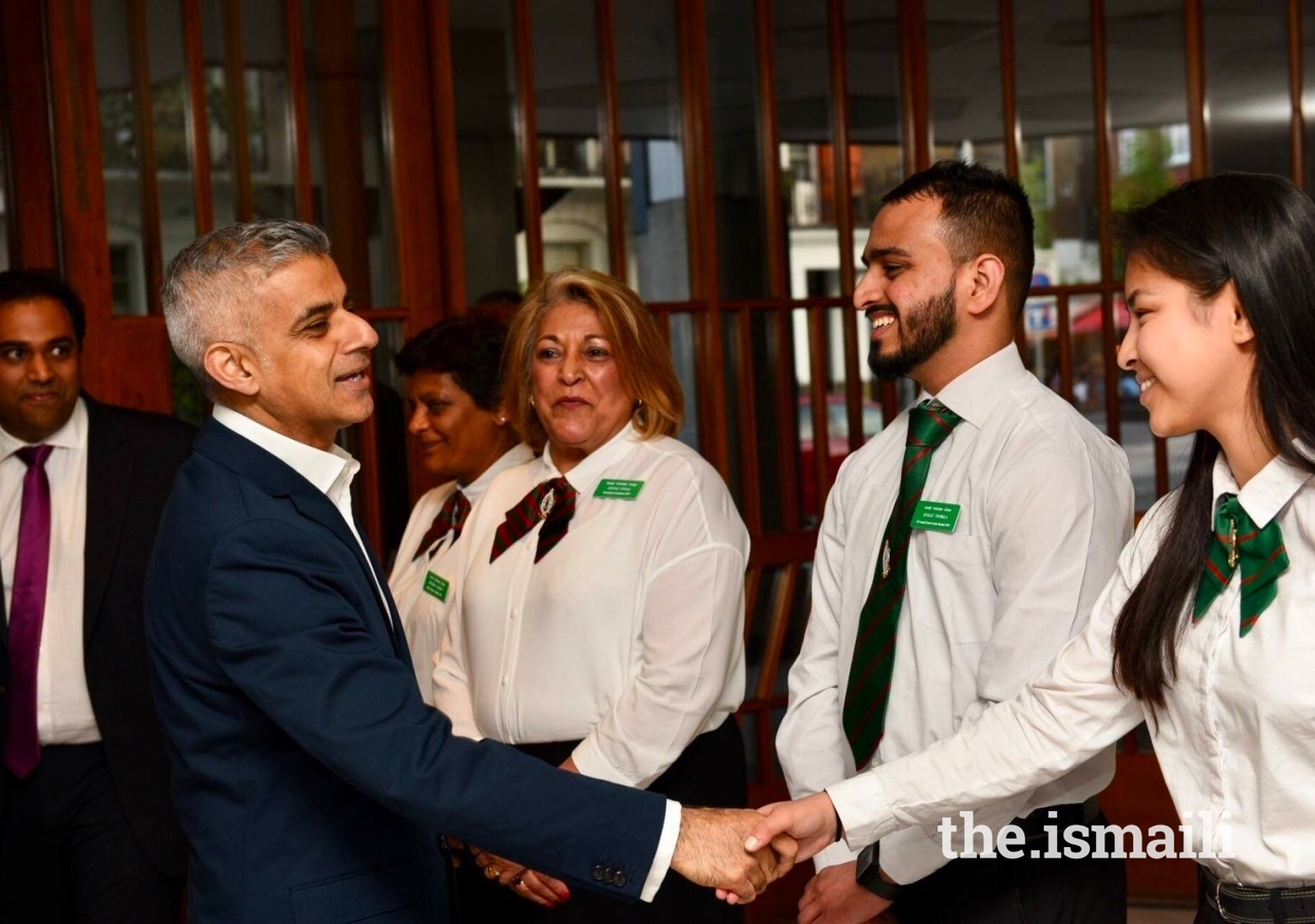 Mayor of London Sadiq Khan is greeted by young members of the Ismaili Volunteer Corps at the Ismaili Centre London.