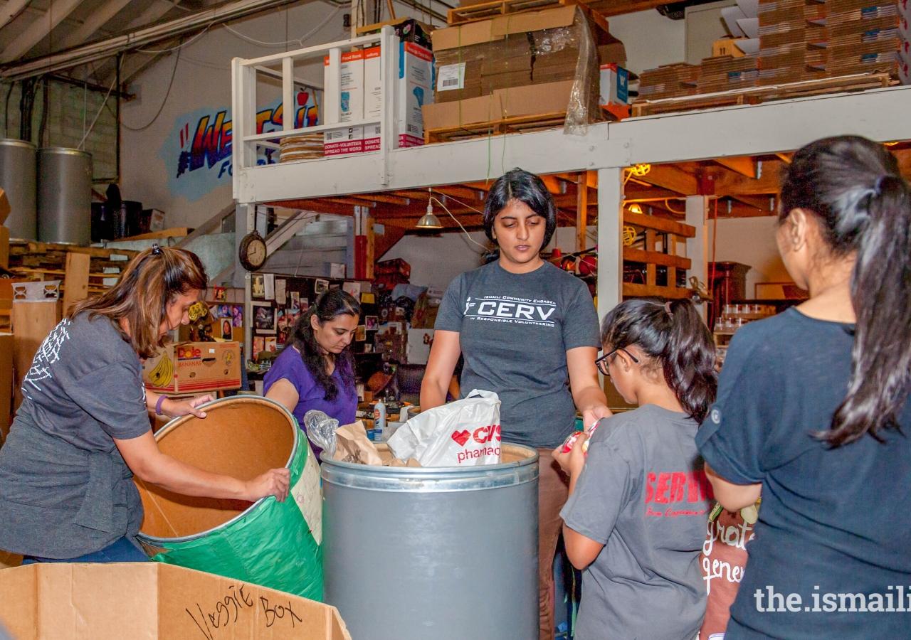 Greater Los Angeles: Volunteers sorting and boxing items at Westside Food Bank in Santa Monica.