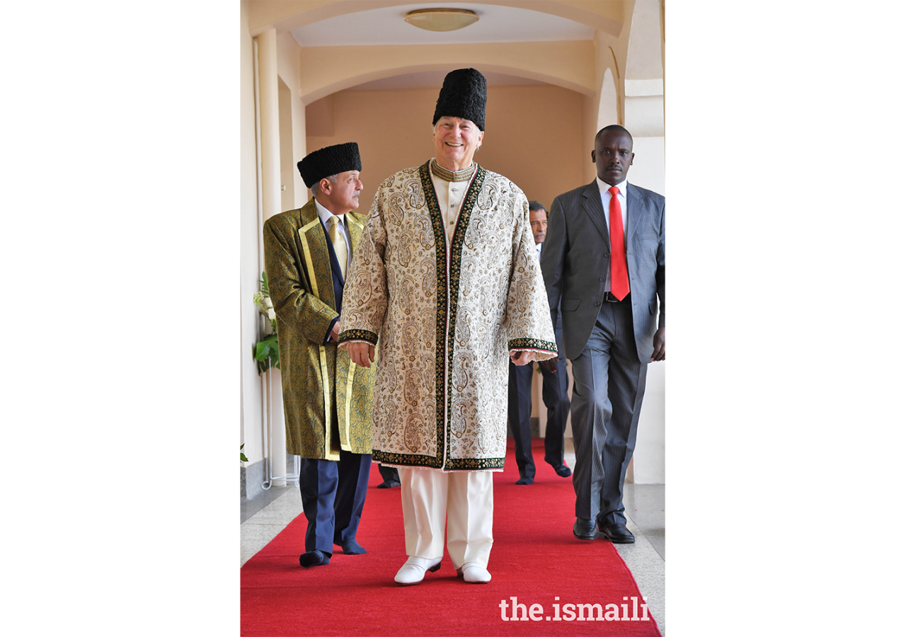 Mawlana Hazar Imam making his way to the Darbar hall to meet with the Ugandan Jamat, followed by President Minaz Jamal.