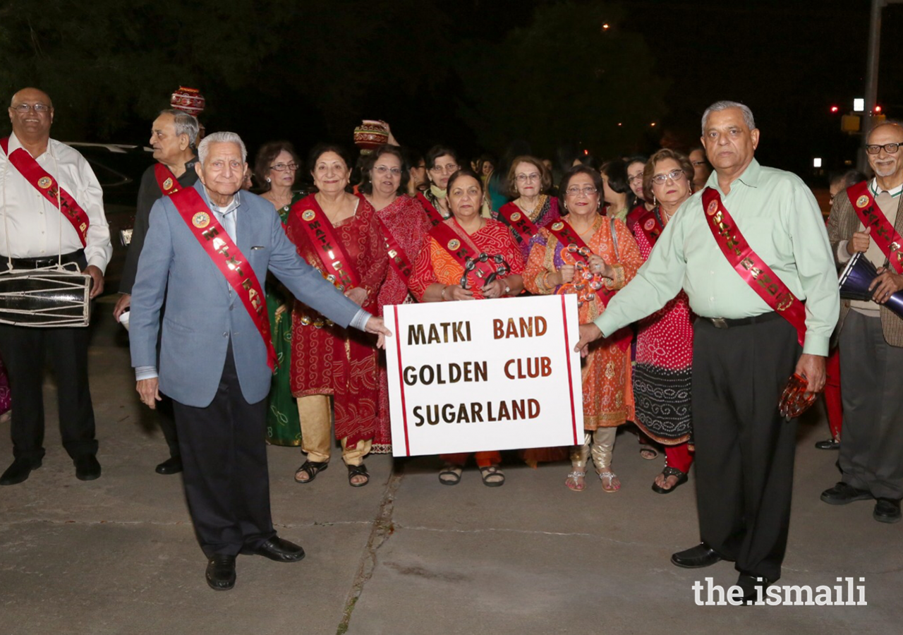 Ismaili Matki Band celebrating alongside other seniors during the Diamond Jubilee USA Mulaqat Celebrations at the Sugarland Jamatkhana, March 15, 2018.