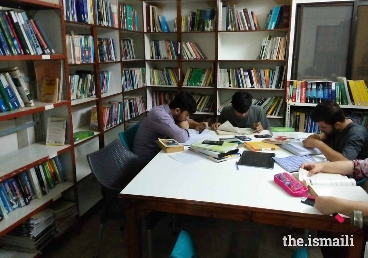 Young students study in the Gulshan-e-Noor Library and Reading Room.
