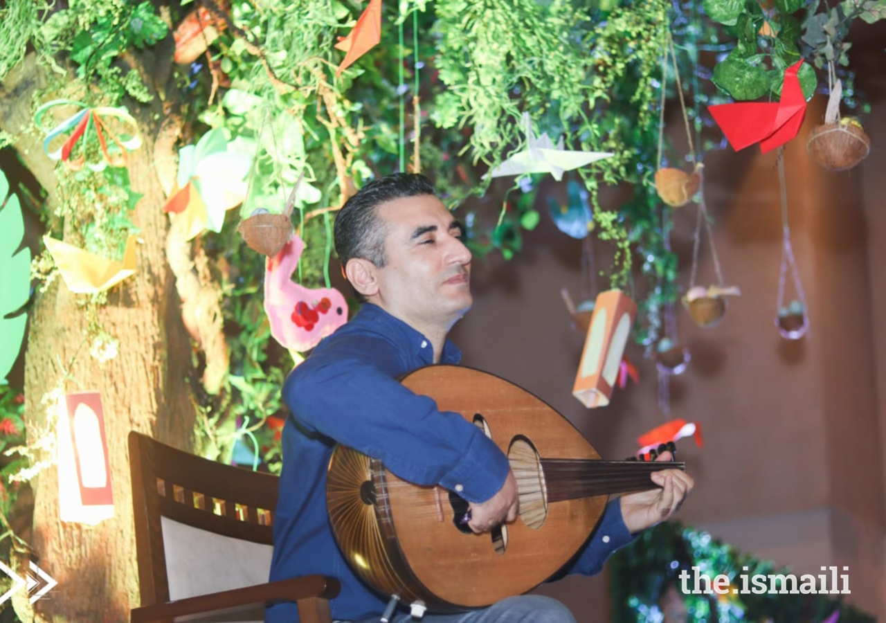 One of the soulful musicians playing the Oud with the DiversiTree in the background.