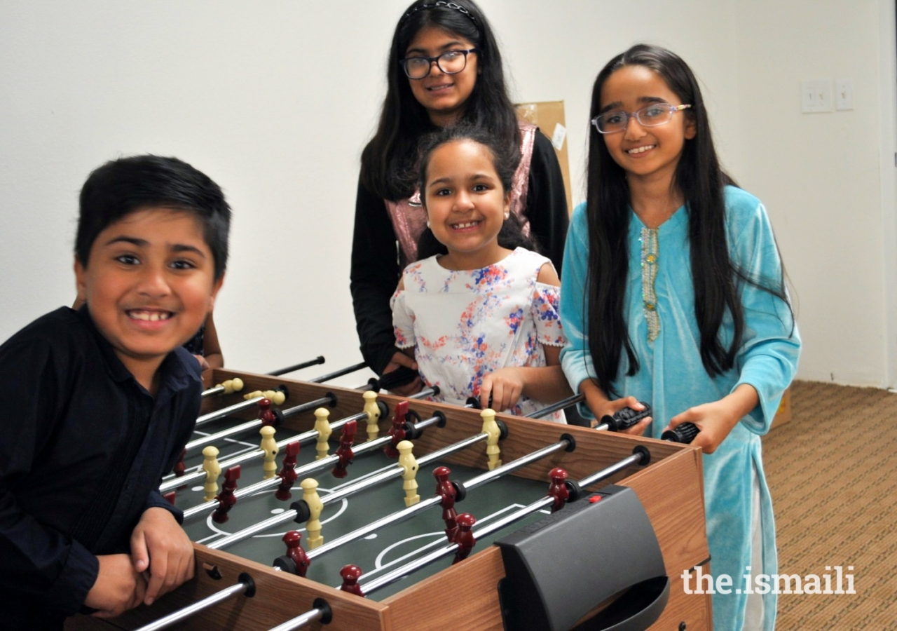Younger members enjoy group activities during Game Night in Miami.
