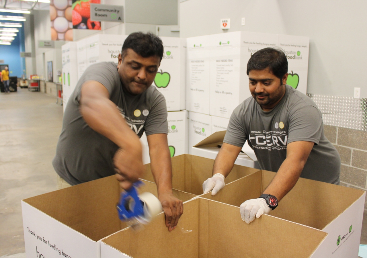 I-CERV Volunteers assemble boxes to sort through donations at Houston Food Bank.