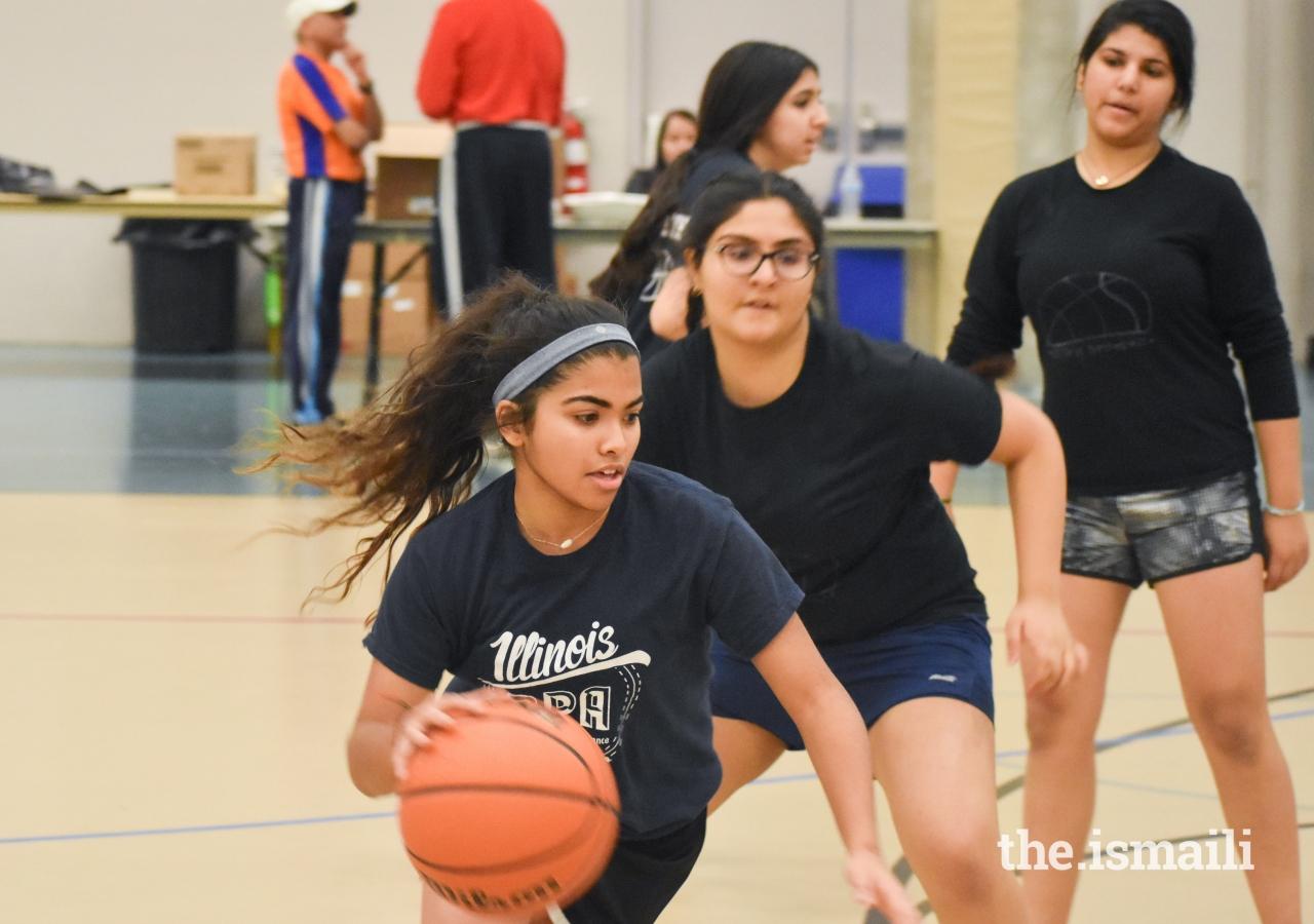 Saaniya Rupani tries to find an open shot, while battling a tough defense.