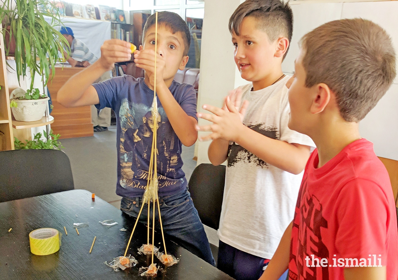 Students try an engineering challenge: to build the tallest tower they can in the time limit using only gummy pieces and spaghetti.