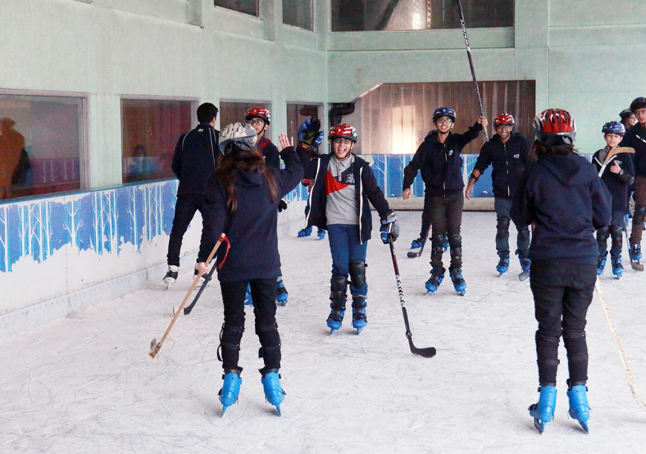 At a skating arena in Karachi, ice hockey players celebrate their victory!