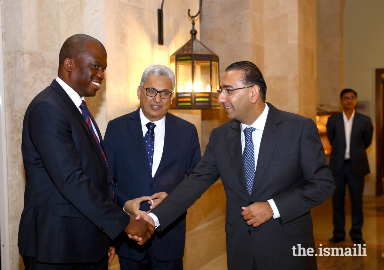 The South African Consul General, Mohobo David  Magabe being received by President of The Ismaili Community of United Arab Emirates, Amiruddin Thanawalla and Murtaza Hashwani