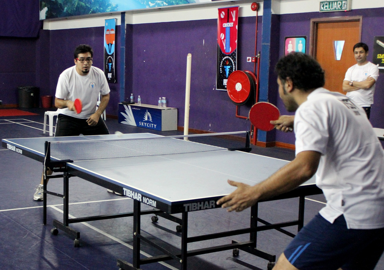 Kuala Lumpur and Thailand compete in a game of table tennis. Salman Motani