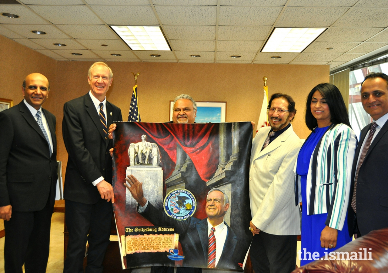 Madataly Rajabaly (on right of painting) presenting his portrait of  Governor Bruce Rauner of Illinois (on left of painting).