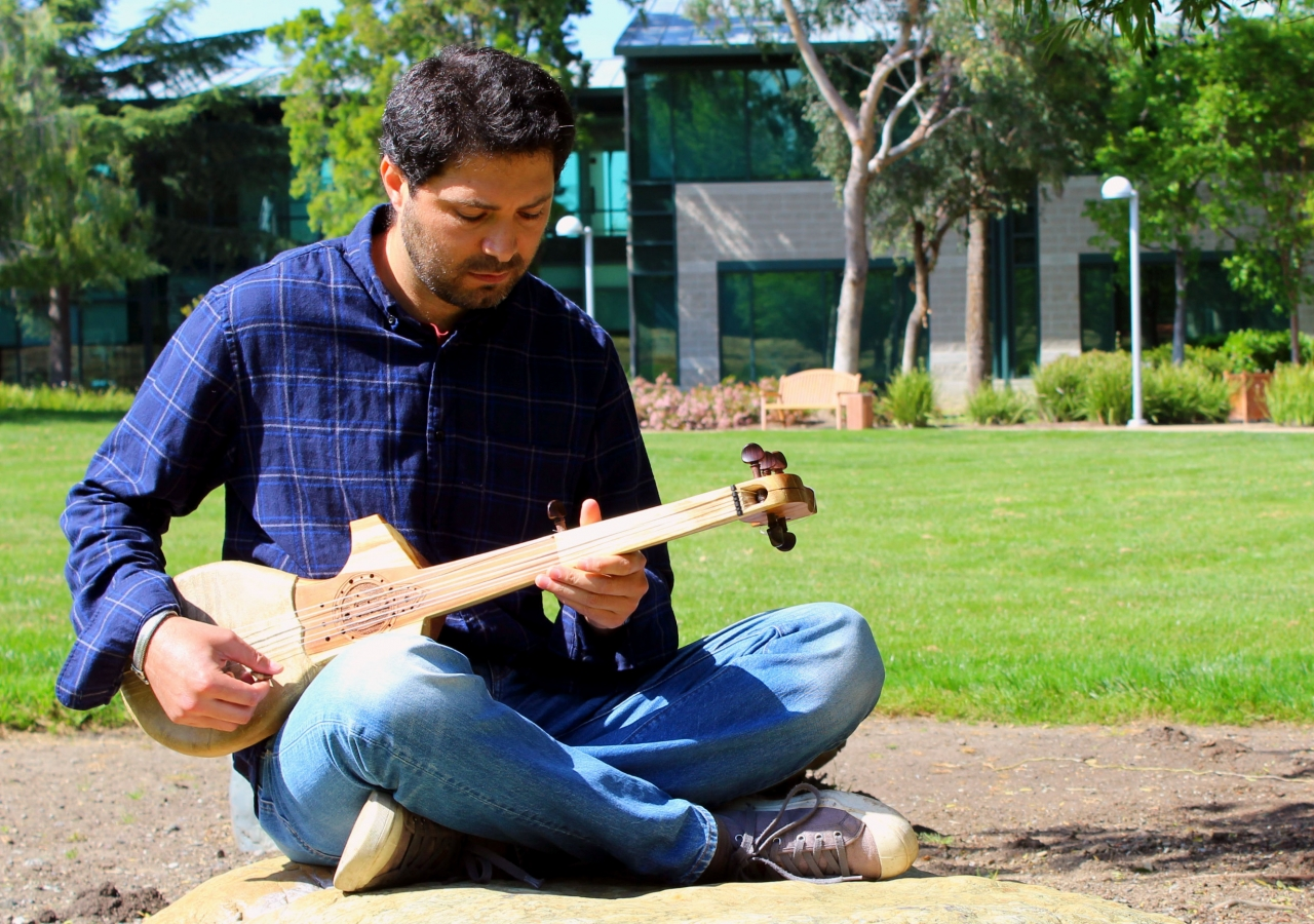 Maruf Noyoft with his rubab.