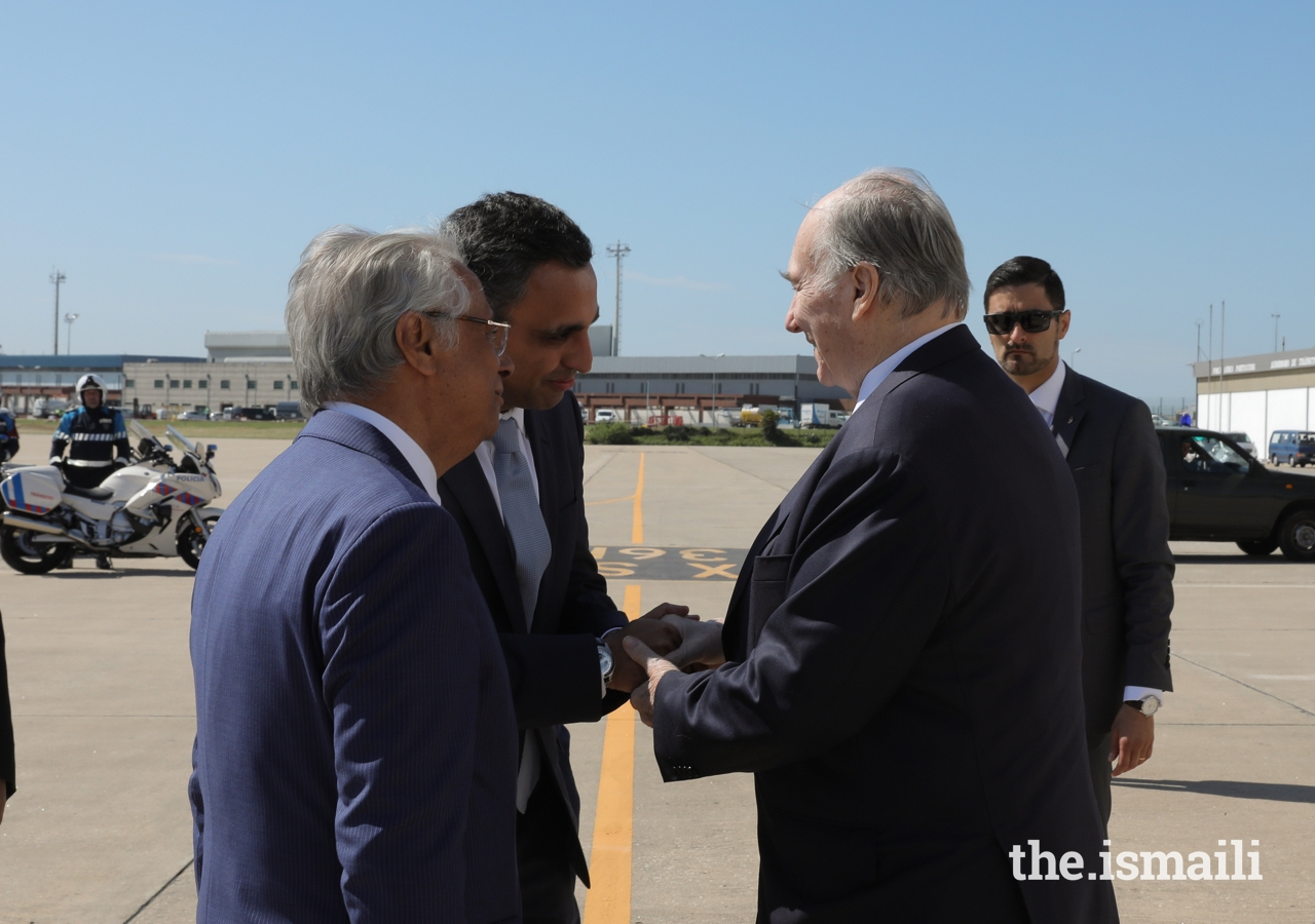 Mawlana Hazar Imam is greeted by Rahim Firozali, President of the Ismaili Council for Portugal, as Nazim Ahmad, Diplomatic Representative of the Ismaili Imamat to the Portuguese Republic looks on.