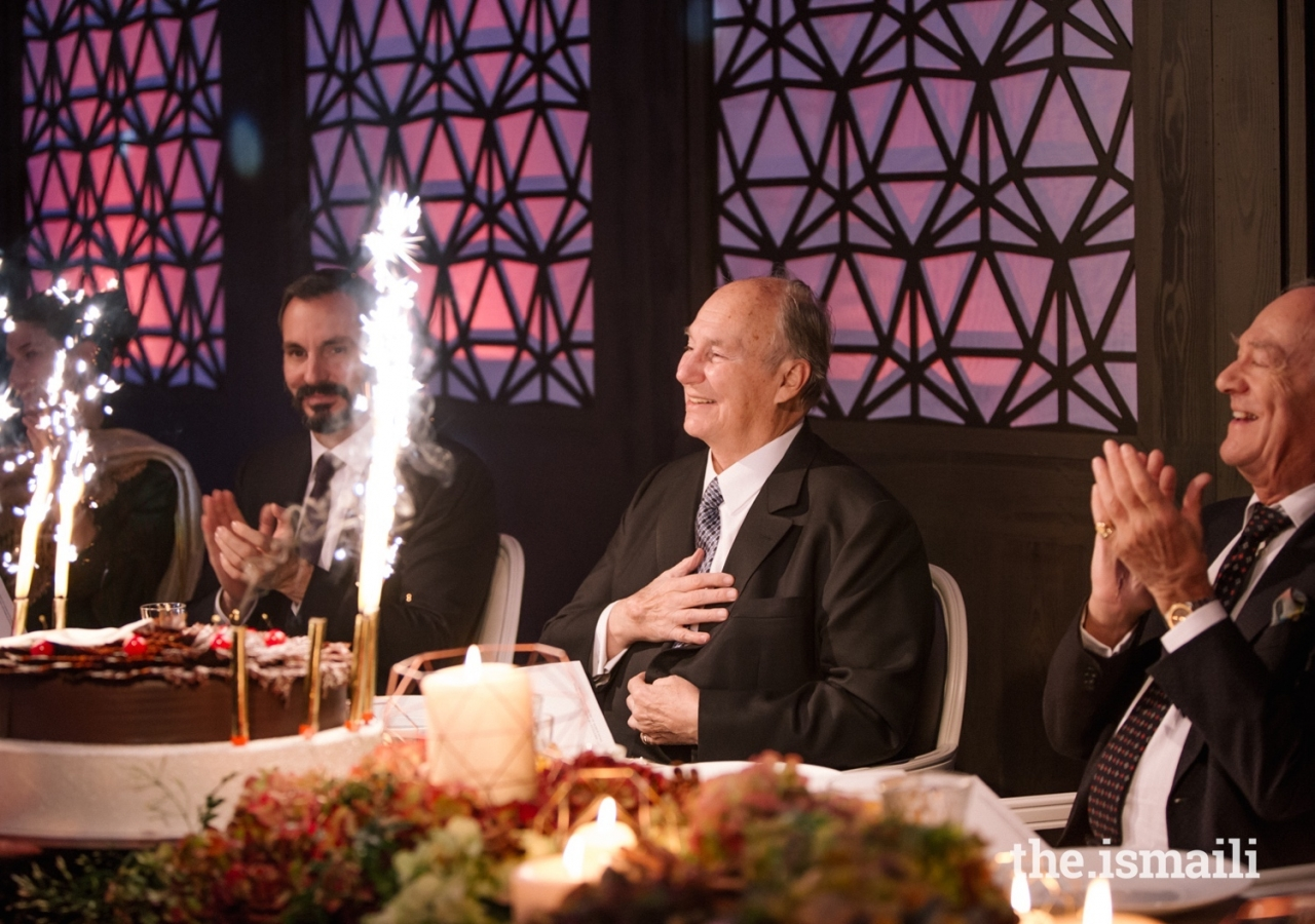 Mawlana Hazar Imam is presented with a cake on behalf of the worldwide Jamat on the occasion of his 80th birthday.